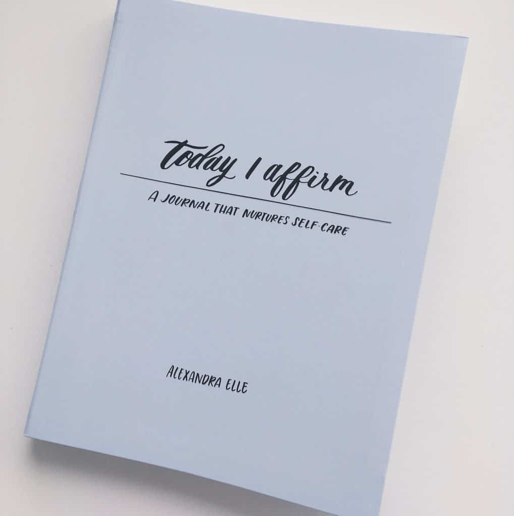 """A copy of """"Today I Affirm: A Journal that Nurtures Self-Care"""" by Alexandra Elle"""