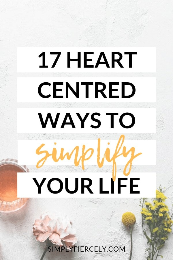 "Title text ""17 Heart-Centred Ways to Simplify Your Life"" in white boxes over image of flowers and a pink drink against a rough white surface."