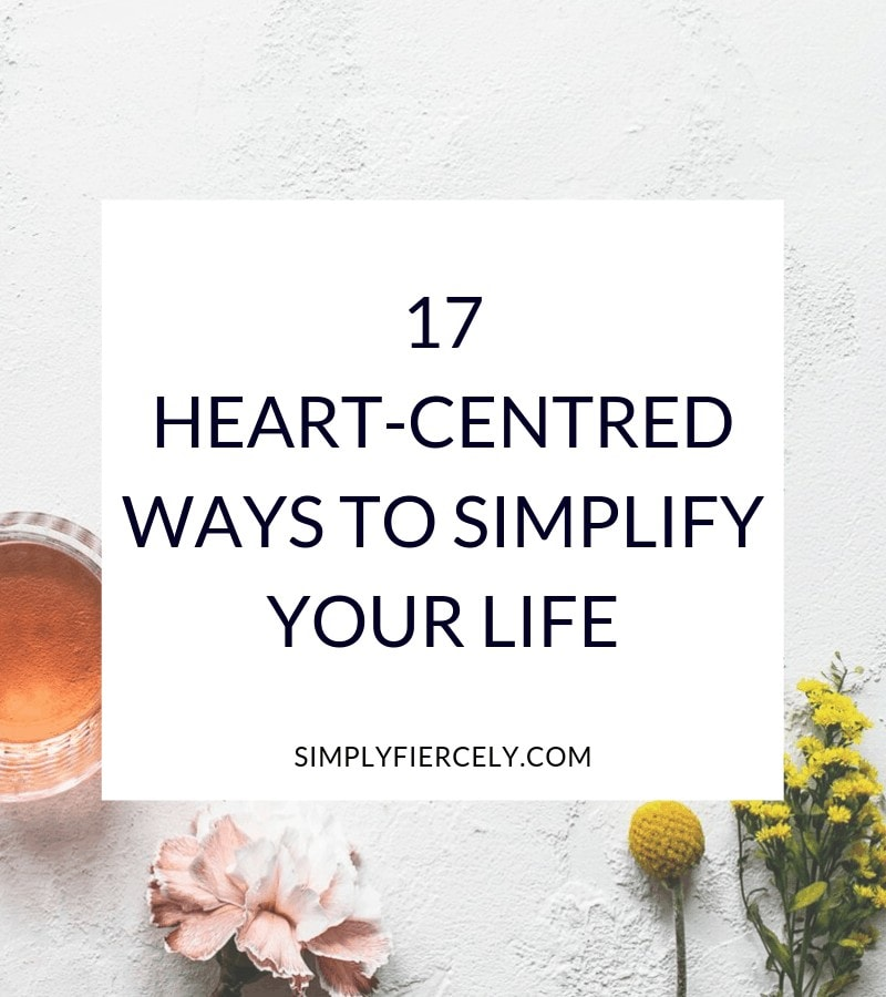 "Title text ""17 Heart-Centred Ways to Simplify Your Life"" in white box over image of flowers and a pink drink against a rough white surface."