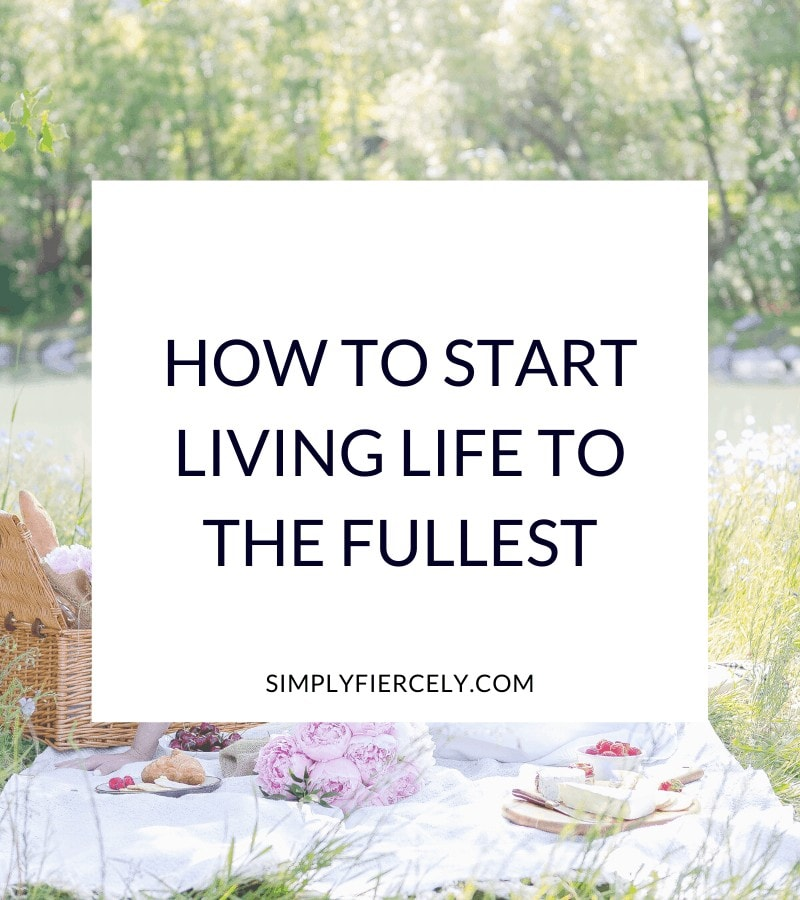 """How to Start Living Life to the Fullest"" in a white box with a woman sitting on a blanket drinking lemonade and having a picnic outside beside a stream in the background."