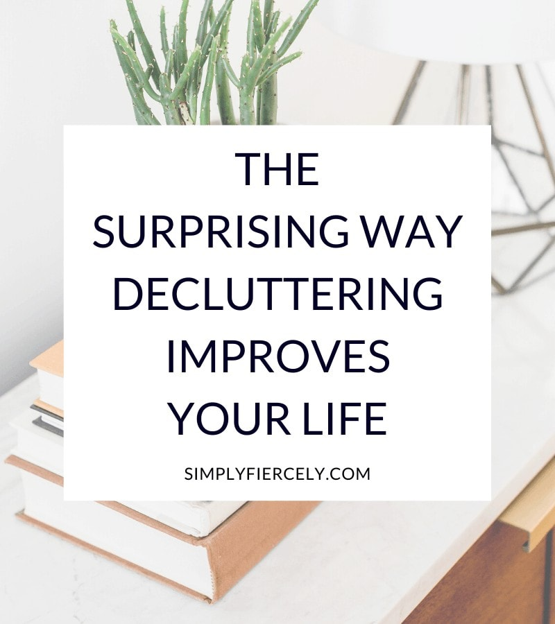 """The Most Surprising Way Decluttering Improves Your Life"" in a white box with a stack of books, a plant, and a lamp in the background."