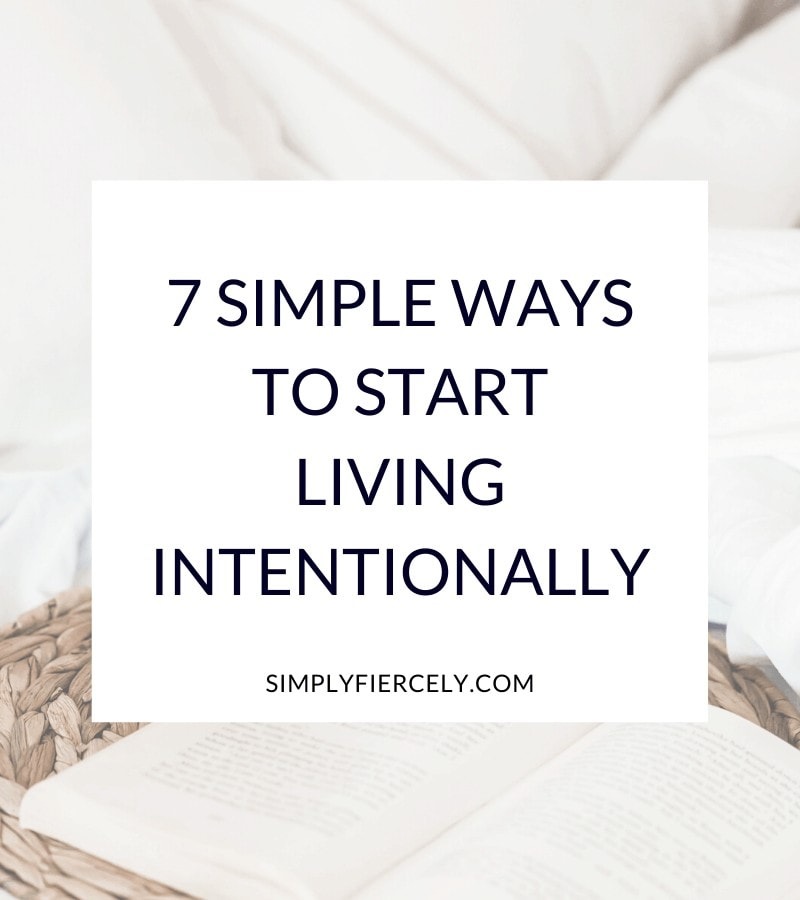 """7 Simple Ways To Start Living Intentionally"" in a white box with a woven mat and book in the background."