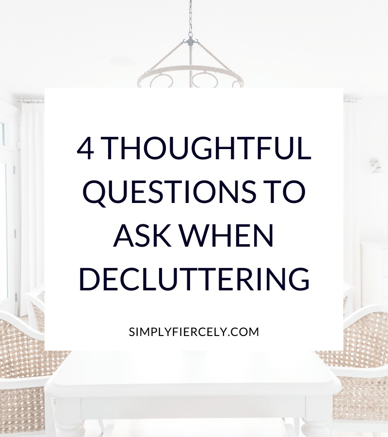 """""""4 Thoughtful Questions to Ask When Decluttering"""" in a white box with a white dining table and wicker dining chairs in the background."""