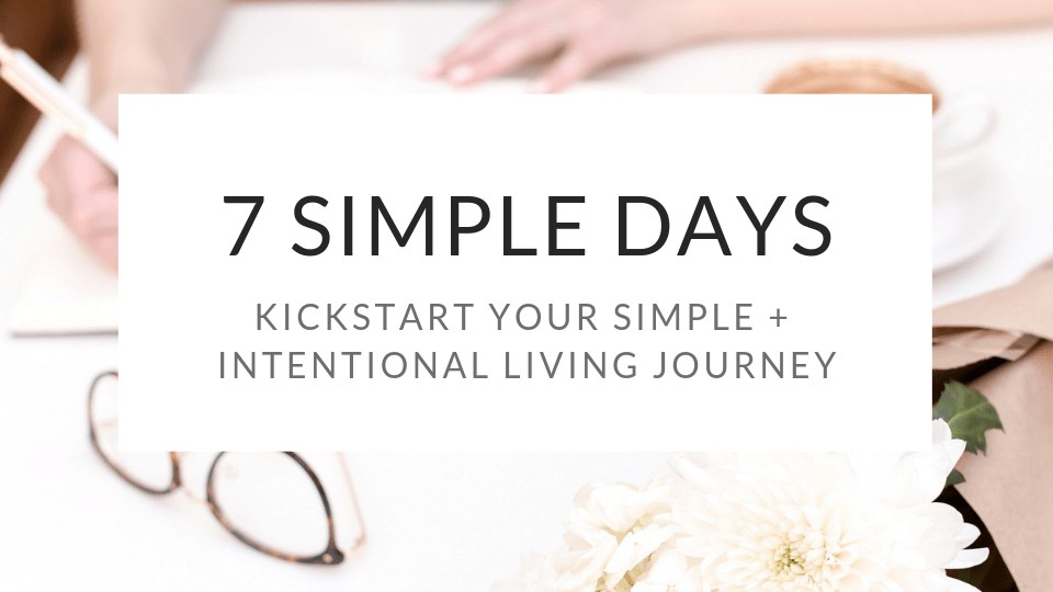 """""""7 Simple Days Kickstart Your Simple + Intentional Living Journey"""" in a white box with a woman writing in the background."""