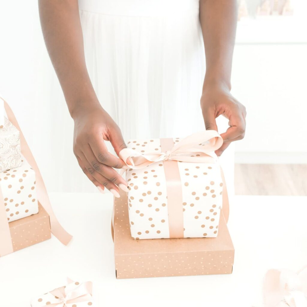 A woman wrapping minimalist gifts.