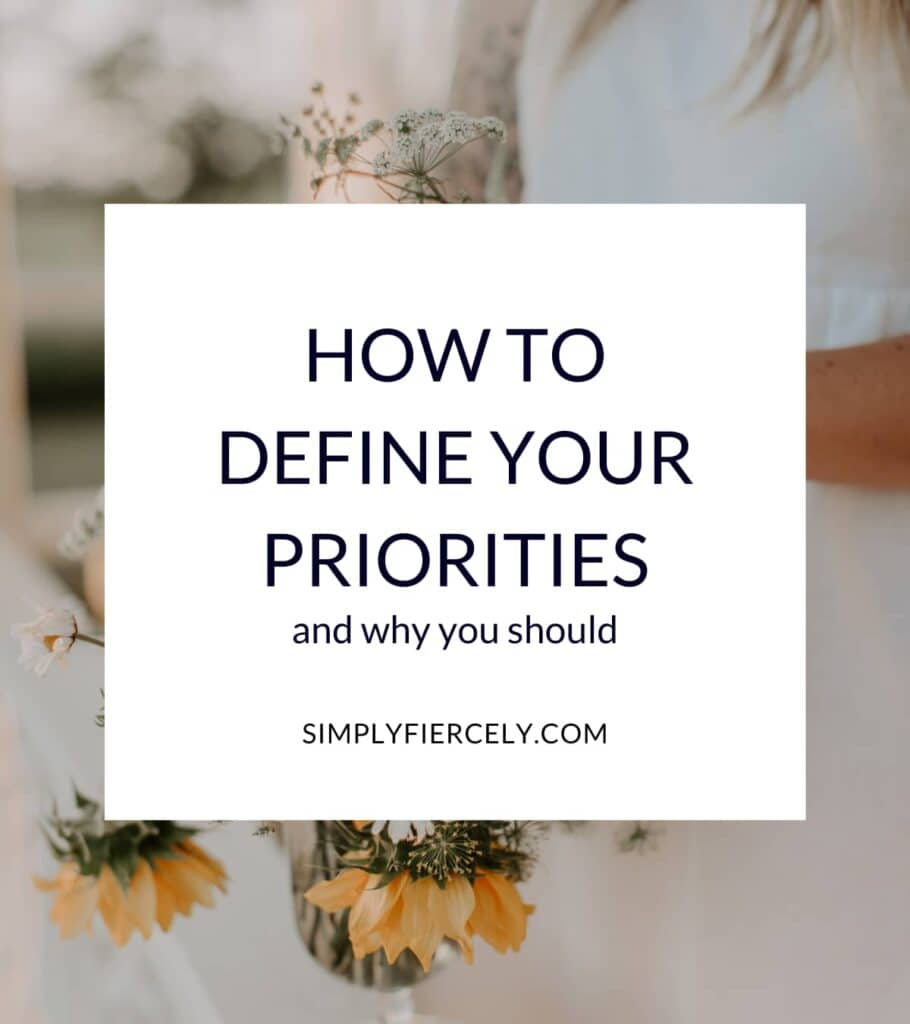 """""""How to Define Your Priorities in Life + Why It Matters"""" in a white box with a woman holding yellow and white flowers in the background."""