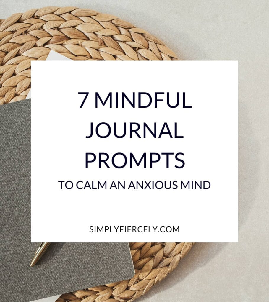"""""""7 Mindful Journal Prompts to Calm Your Anxious Mind"""" in a white box with a woven mat with sheets of paper, a journal, and gold pen on top in the background."""
