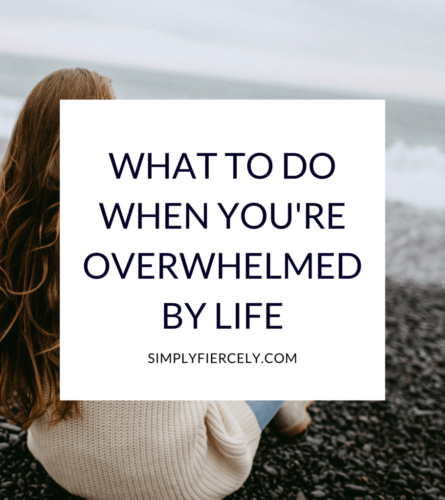 """""""7 Things You Can Do When You're Feeling Overwhelmed By Life"""" in a white box with a woman sitting on a beach watching the waves on a cloudy, dreary day in the background."""