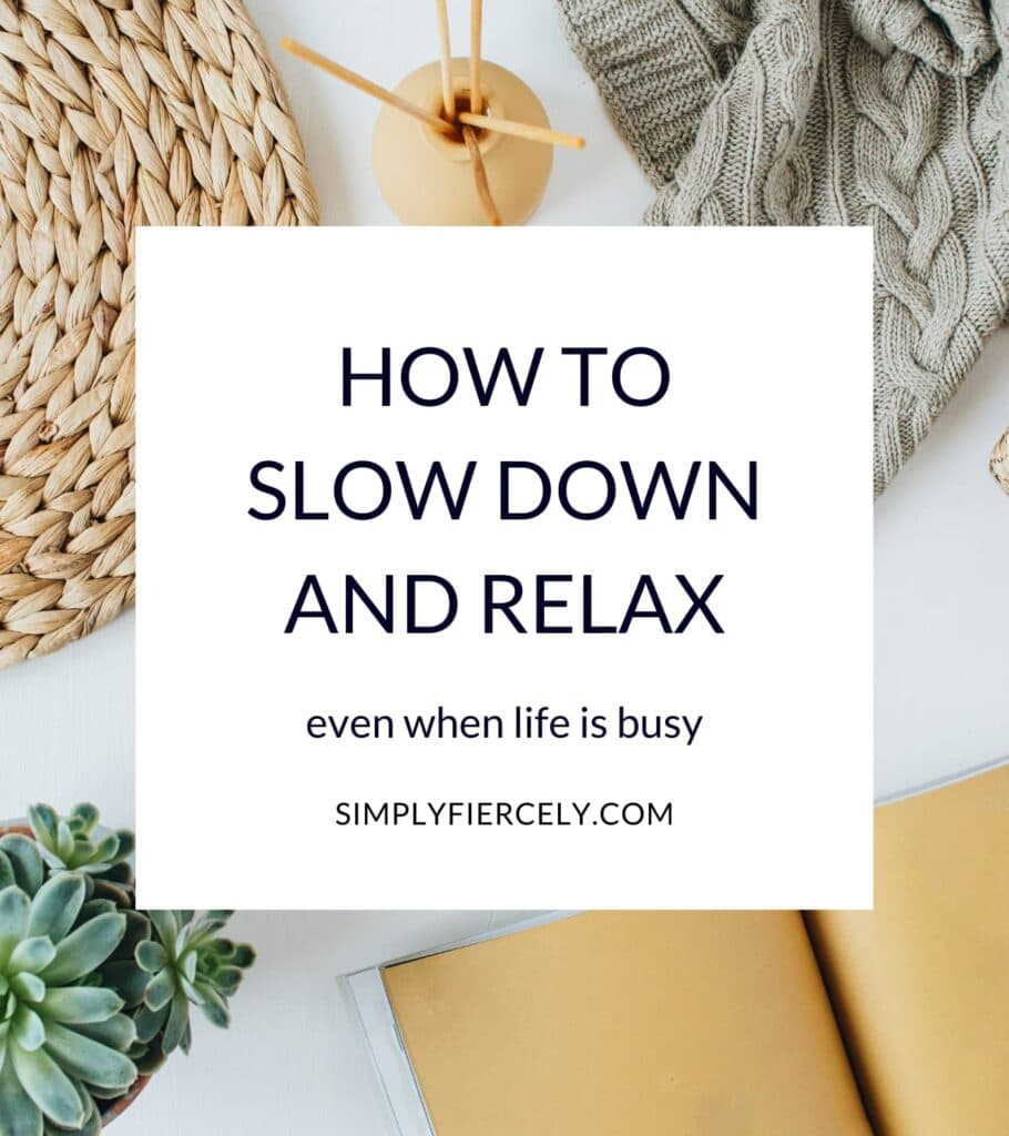 """Foreground: A white box with the text """"How To Slow Down And Relax, Even When Life Is Busy"""" Background: a bright and cozy scene with a sweater, journal, and plant."""