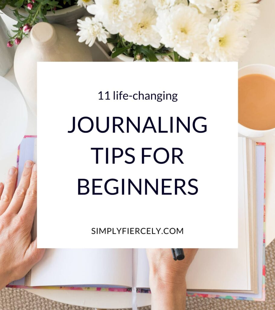 """""""11 Life-Changing Journaling Tips For Beginners"""" in a white box with an image of a woman's hand writing in an open journal, a vase of flowers, and a cup of coffee in the background."""