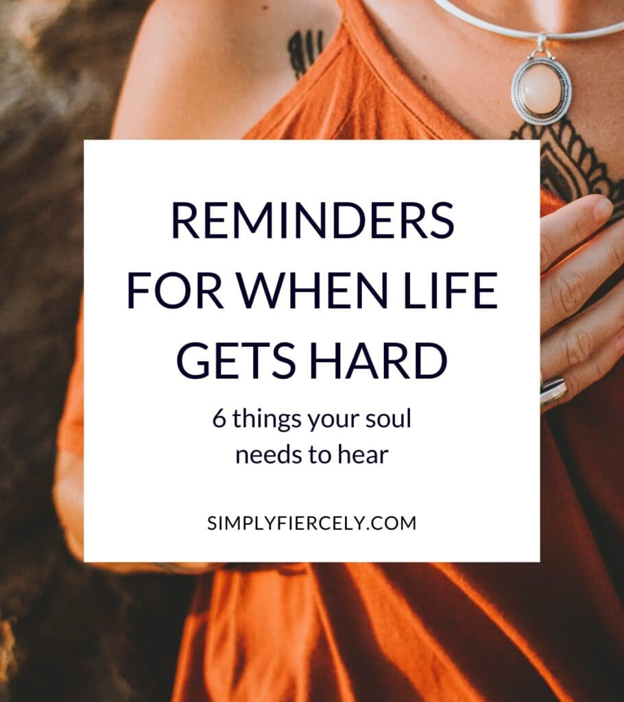 """Background image: woman wearing a boho orange dress with her hand on her chest 