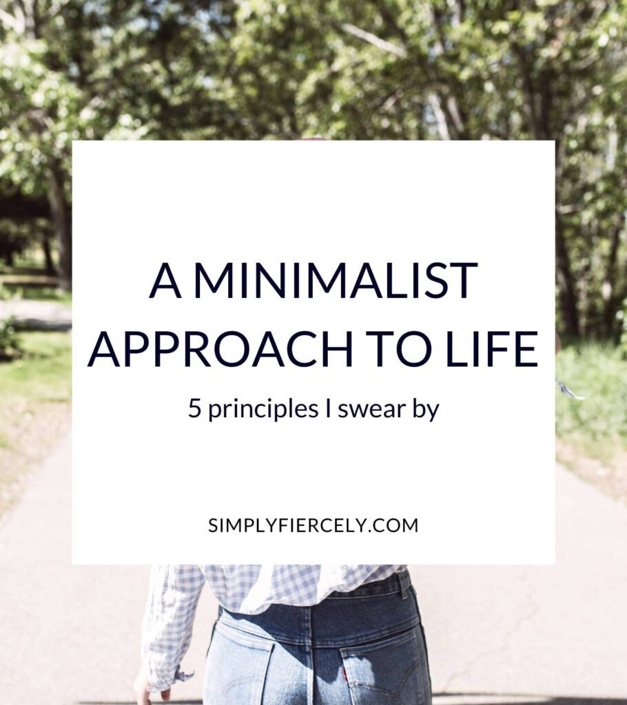 """""""A Minimalist Approach to Life 5 Principles I Swear By"""" in a white box with a woman wearing blue jeans and a blue checkered top walking outside on a sidewalk toward some trees."""