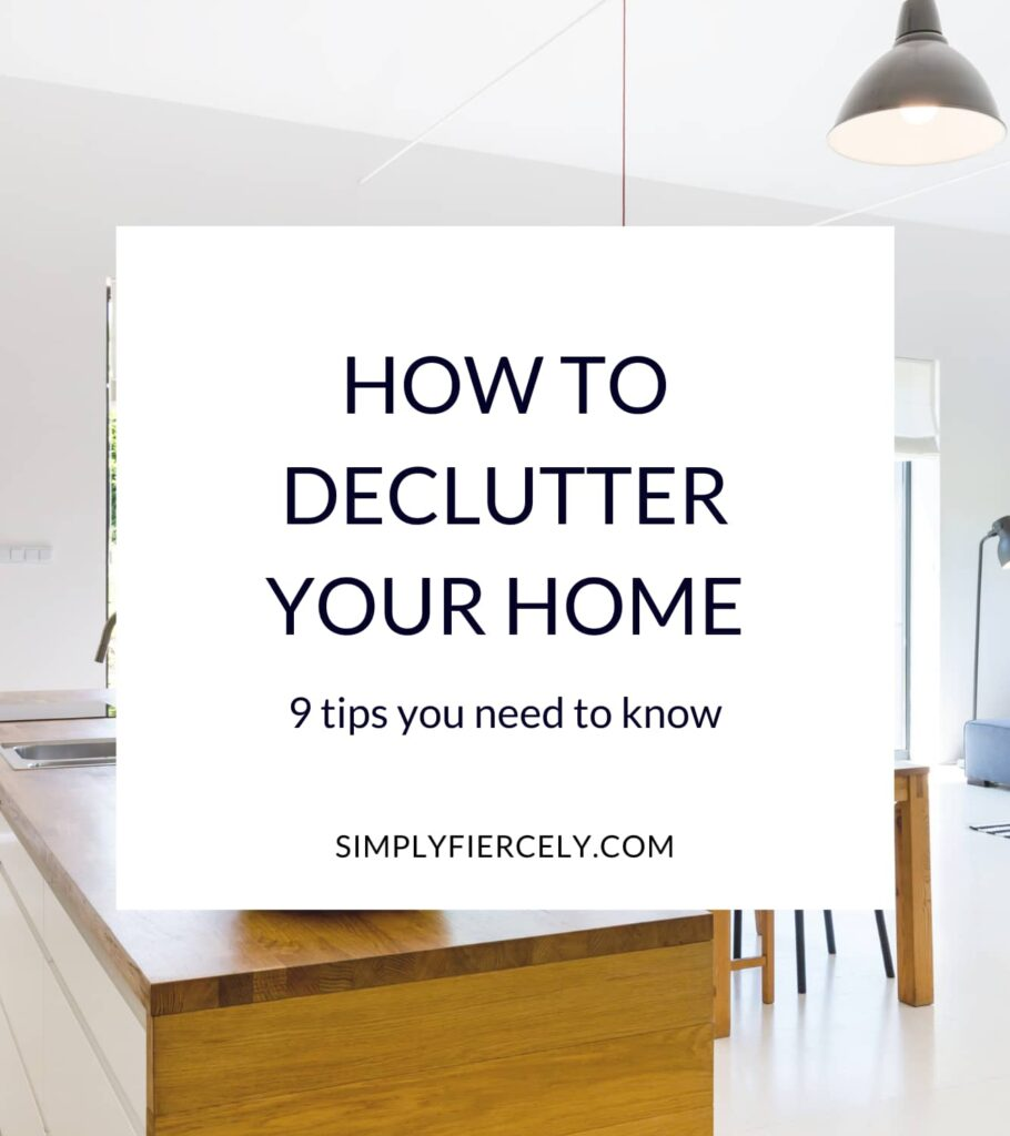 """""""How to Declutter Your Home 9 tips you need to know"""" in a white box with a clutter-free wood tone kitchen island in the background."""