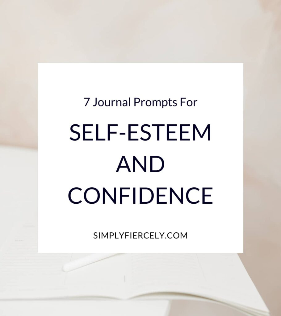 """""""7 Journal Prompts For Self-Esteem and Confidence"""" in a white box with an open blank journal and a pen on a white table in the background."""