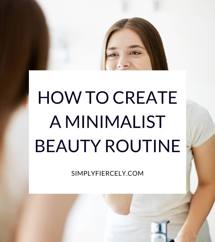 """""""How to Create a Minimalist Beauty Routine"""" in a white box with an image of a woman wearing a white t-shirt and pants looking in the mirror"""